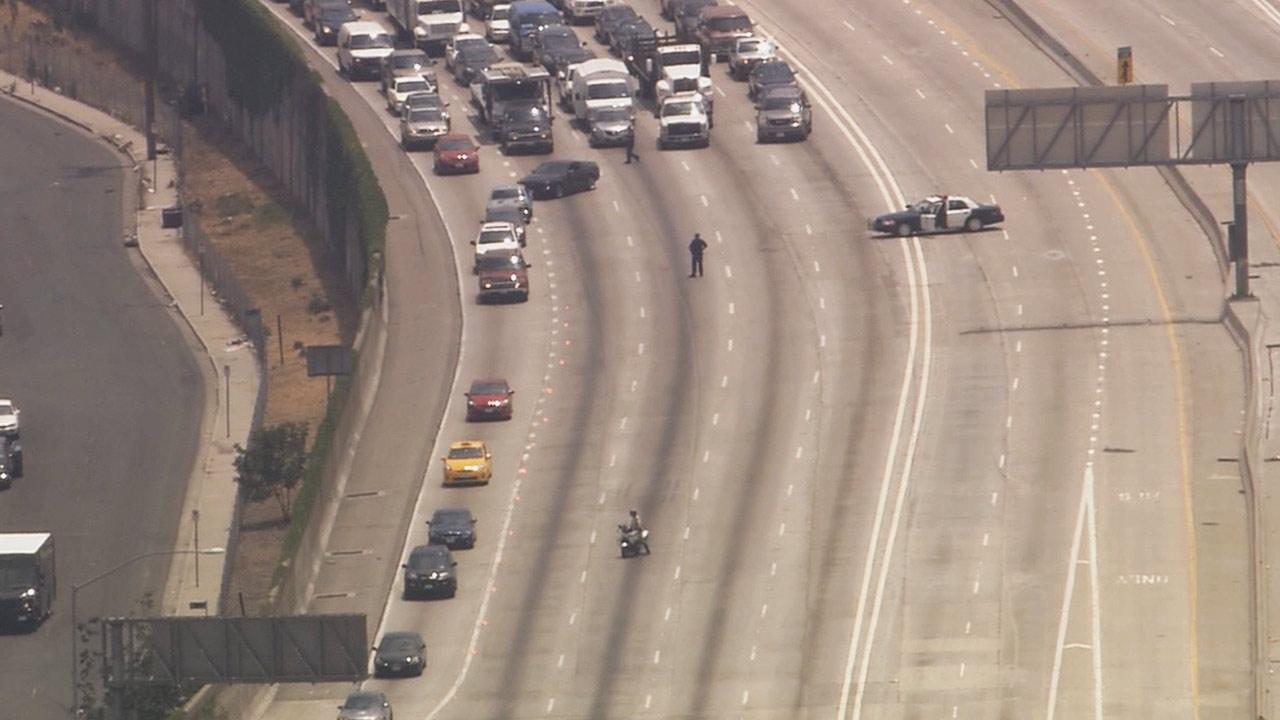 Northbound lanes of the 110 Freeway were shut down between the 105 Freeway and Florence Avenue due to a car-to-car shooting Tuesday afternoon, July 2, 2013.