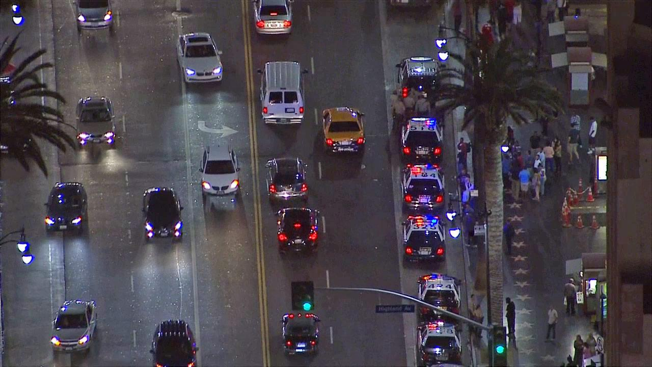 Police vehicles are seen in Hollywood after authorities said a group of juveniles robbed and assaulted people on Tuesday, July 16, 2013.