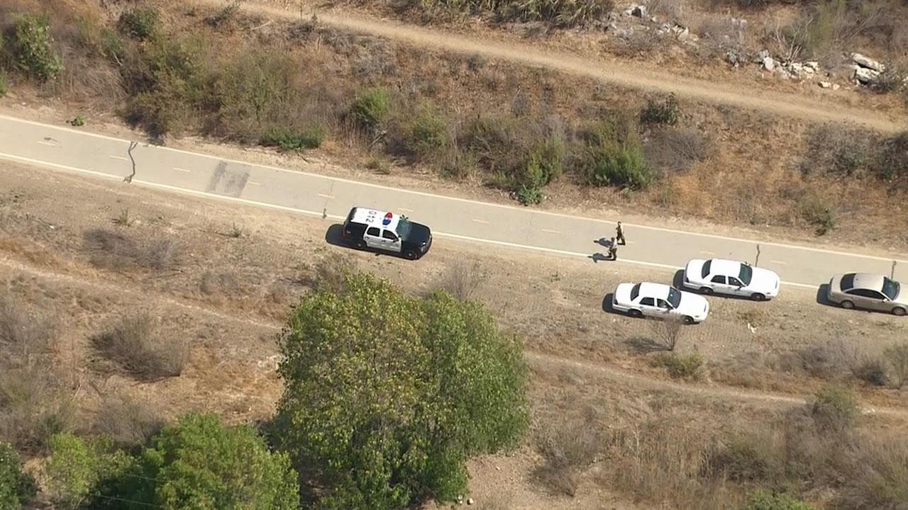 Police investigate after human remains were found in Montebello on Wednesday, July 31, 2013.