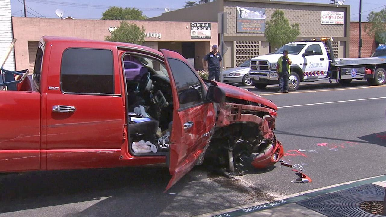 A police pursuit came to an end after the suspect vehicle, the red pickup truck seen in this photo, crashed on Burbank Boulevard near Lima Street on Saturday, Aug. 3, 2013.