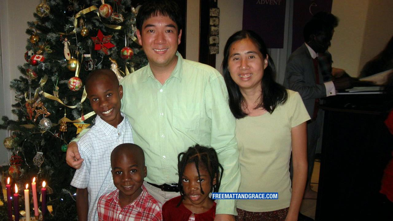 Matthew and Grace Huang are seen with their three adopted children in this undated photo.