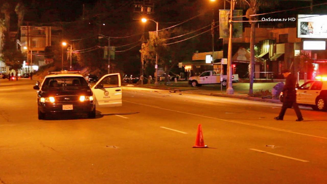 Police investigate a hit-and-run crash on Ventura Boulevard east of Fairway Avenue in Studio City that left a man dead on Saturday, Aug. 17, 2013.