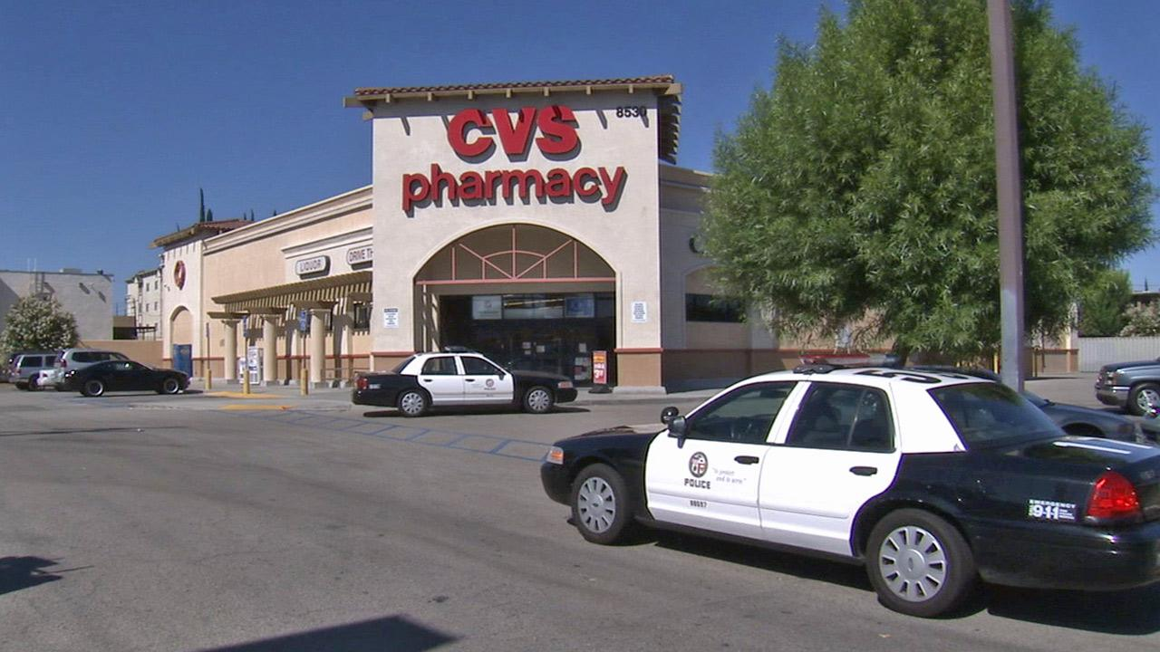 Los Angeles police respond to a report of a double stabbing at the CVS pharmacy on the 7400 block of Reseda Boulevard in Reseda on Saturday, Aug. 17, 2013.