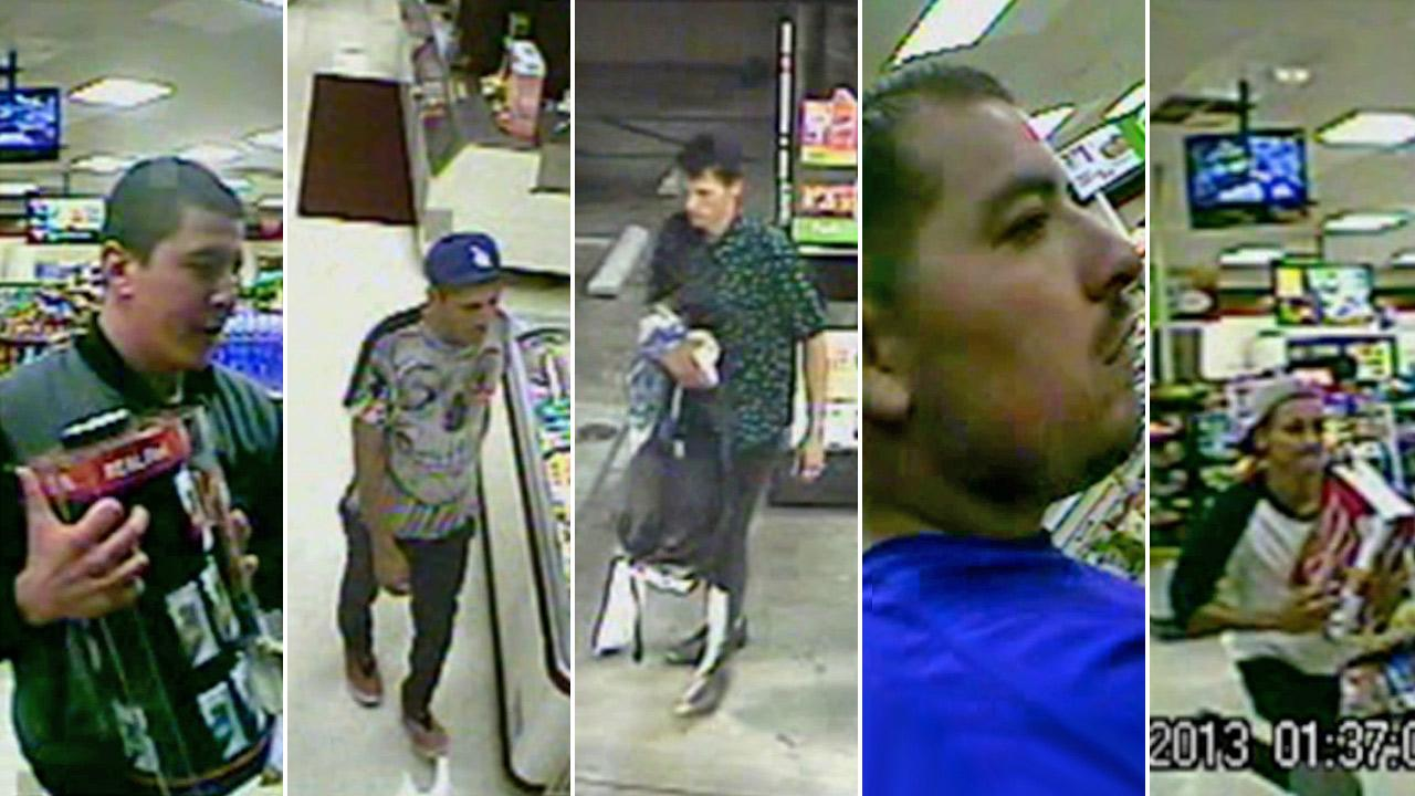 Surveillance still images show the suspects sought in a series of robberies at a 7-Eleven in Echo Park in July 2013.k