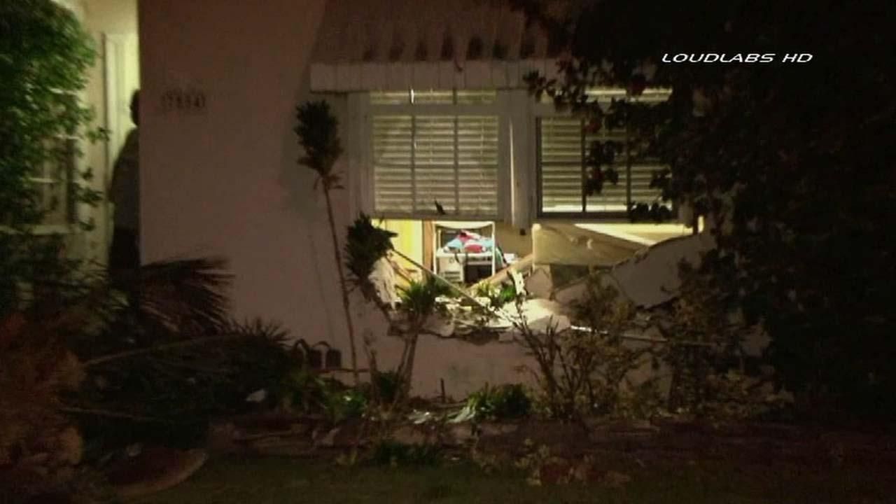 Authorities respond to the scene of a single-vehicle crash that sent a truck into a home in the 7500 block of Vicki Drive in Whittier on Sunday, Sept. 1, 2013.