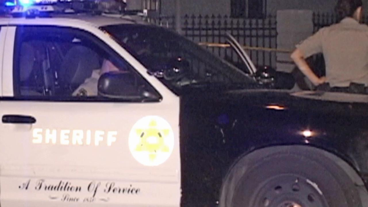 A sheriffs department patrol vehicle is shown at the scene of a shooting in Willowbrook on Wednesday, Sept. 4, 2013.