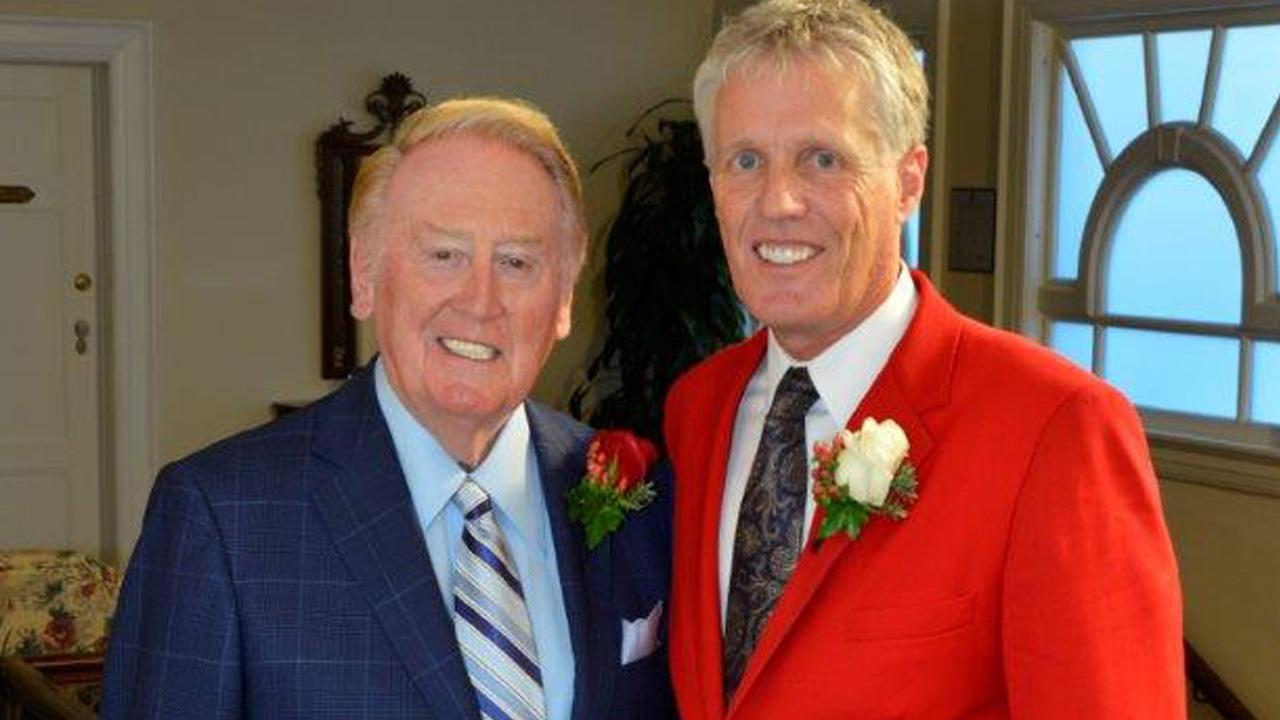 Vin Scully poses for a photo with Tournament of Roses President R. Scott Jenkins on Thursday, Sept. 5, 2013.