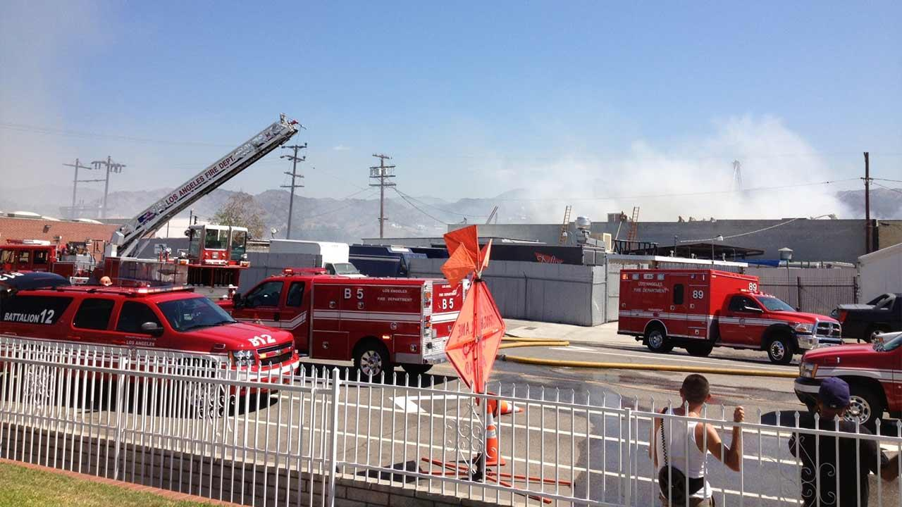 Firefighters are seen battling a blaze at a one-story commercial building at 10680 Elkwood Street in Sun Valley, Saturday, Sept. 14, 2013.