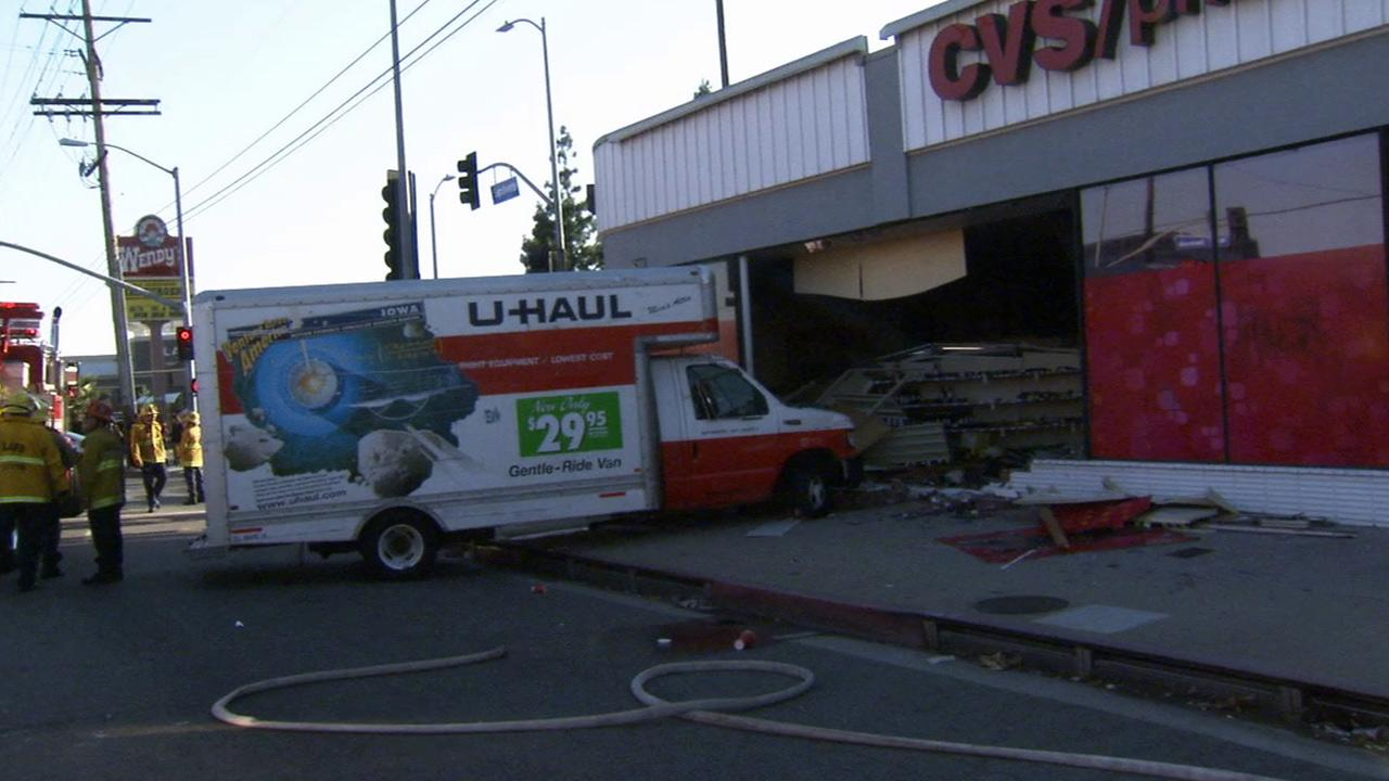 Firefighters respond to a crash involving a U-Haul truck at the CVS drug store in the 6200 block of Sepulveda Boulevard in Van Nuys on Saturday, Sept. 14, 2013.