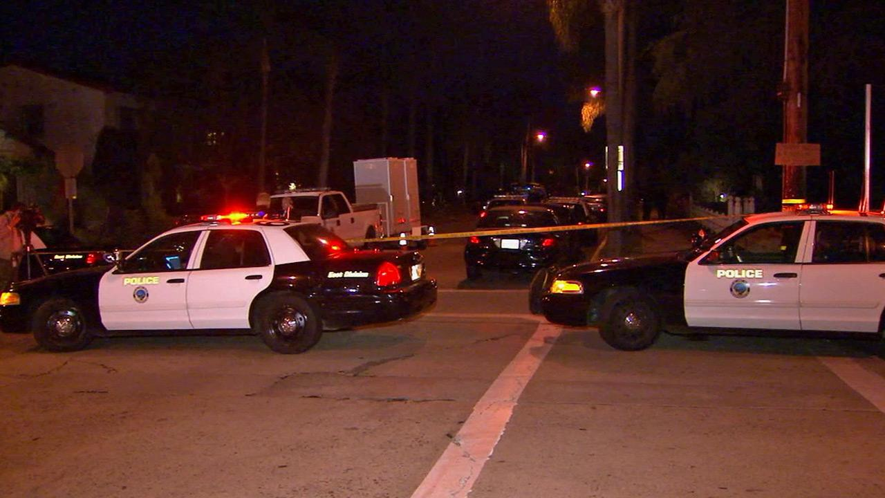 Authorities respond to 2nd Street and Park Avenue in Long Beach following an officer-involved shooting on Saturday, Sept. 21, 2013.