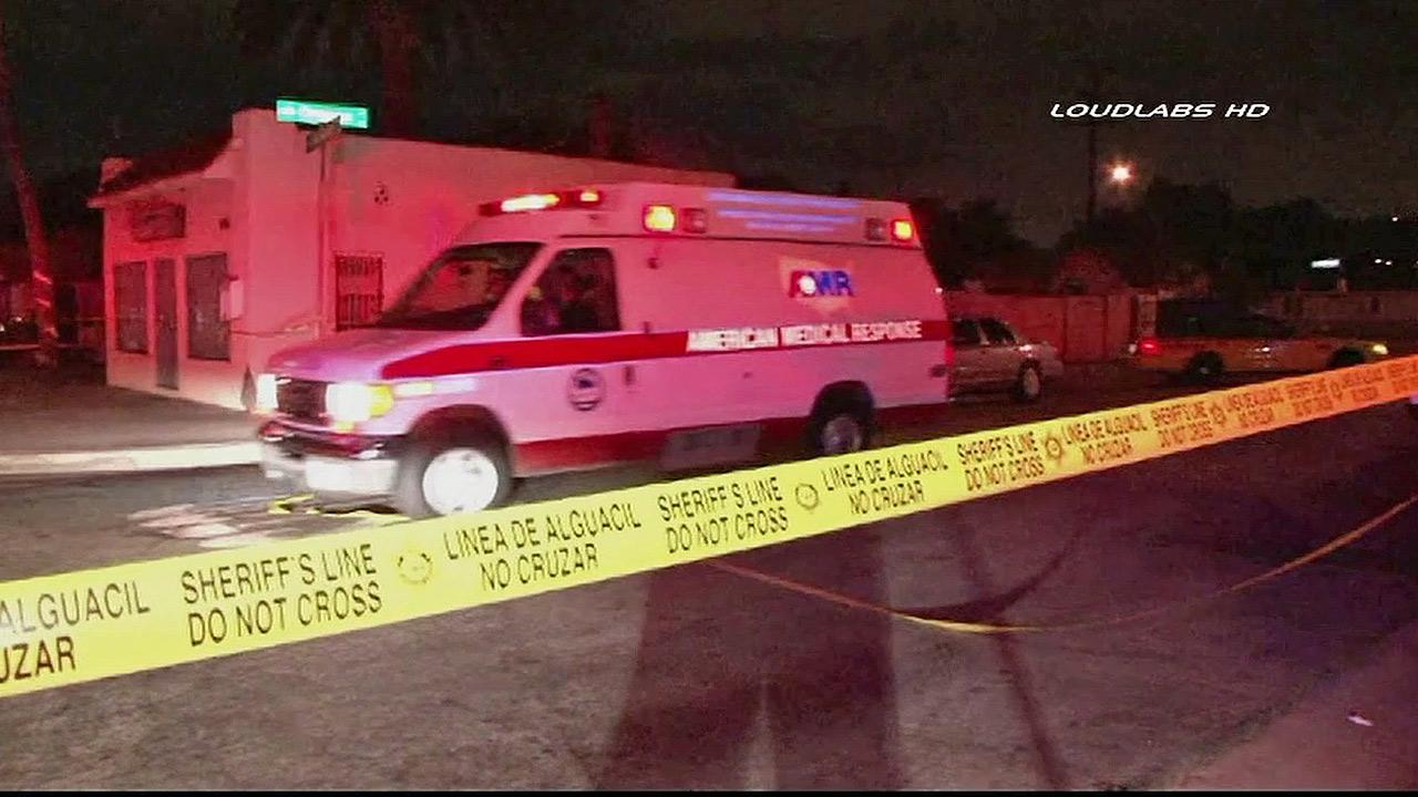Paramedics respond to a triple shooting on the 16100 block of Old Valley Street in La Puente on Sunday, Sept. 22, 2013.