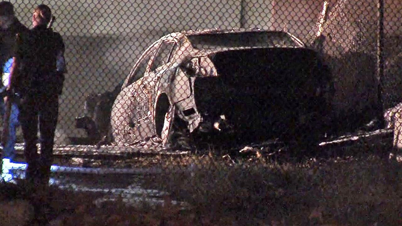 A charred car is shown following a solo crash on the southbound 5 Freeway on the Scott Road off ramp in Burbank on Saturday, Sept. 28, 2013.