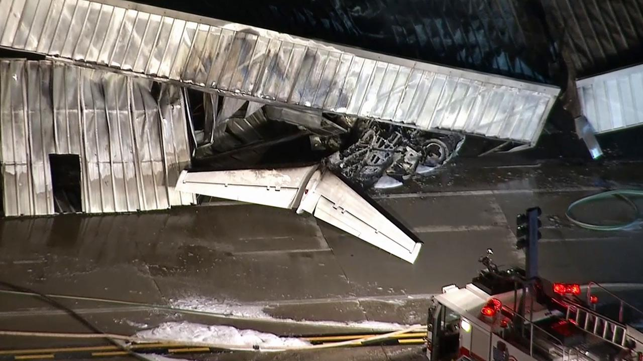 The tail of a small plane that crashed at Santa Monica Airport on Sunday, Sept. 29, 2013, is seen.