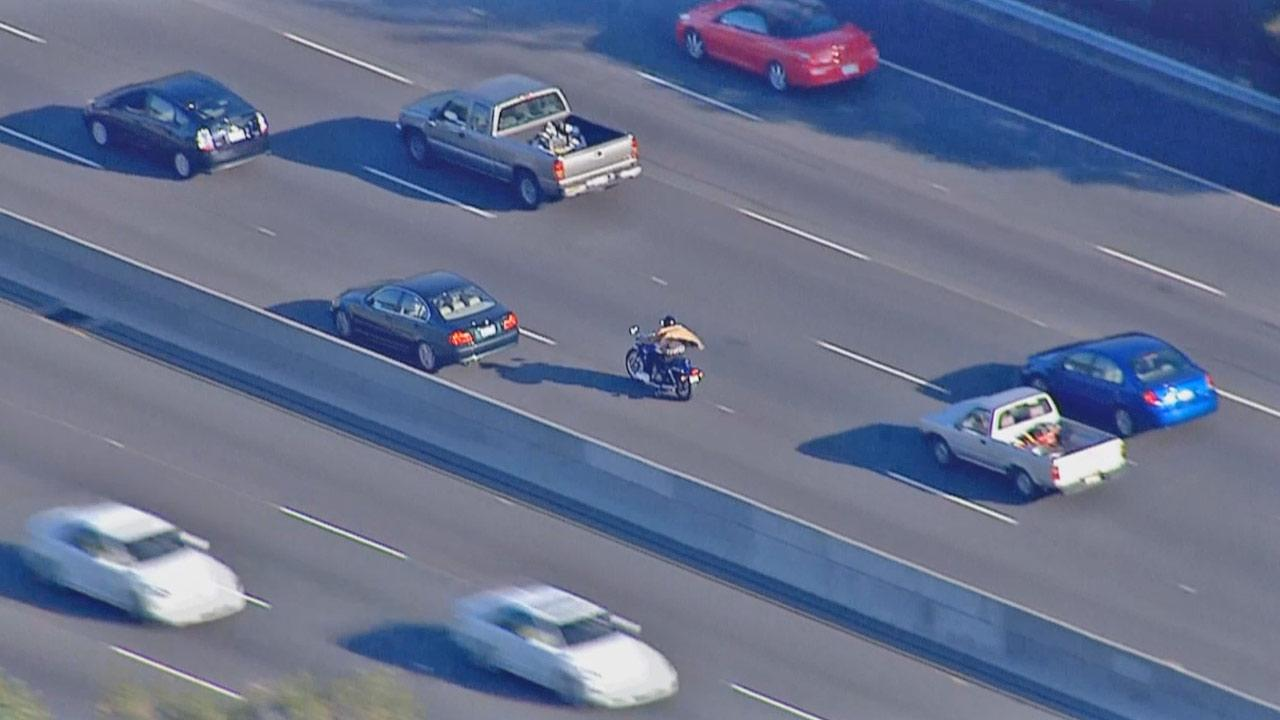 A suspect riding a motorcycle in the San Fernando Valley led police on a high-speed chase into East L.A. Wednesday.