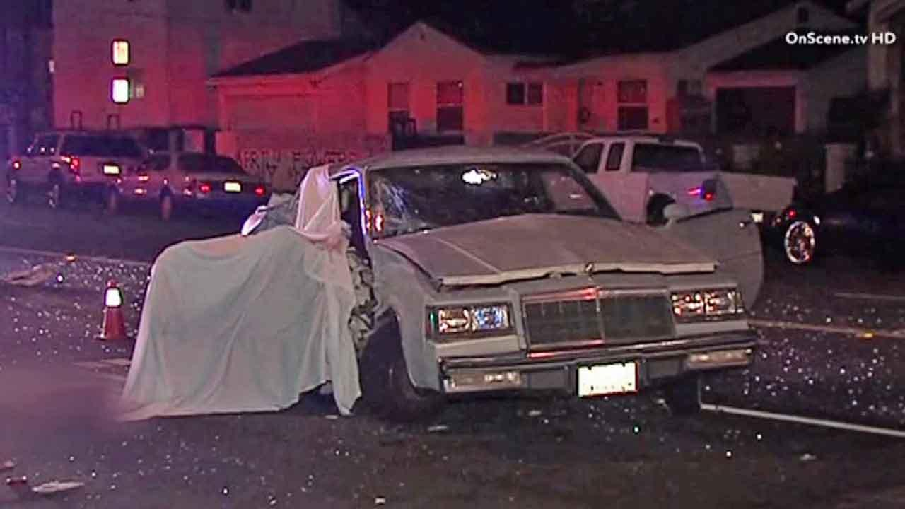 Authorities respond to the scene of a fatal crash near 120th Street and Budlong Avenue in the Athens area of Los Angeles Saturday, Oct. 12, 2013.