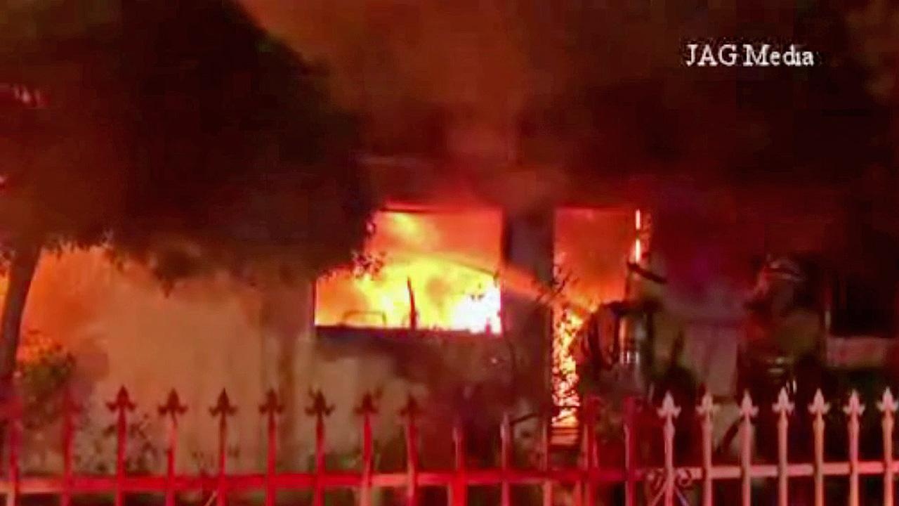 Flames rip through a home in the 6900 block of Agnes Avenue in North Hollywood on Wednesday, Oct. 16, 2013.