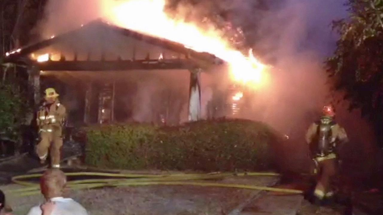 Flames rip through a home in the 900 block of North Evergreen Street in Burbank on Saturday, Oct. 19, 2013.