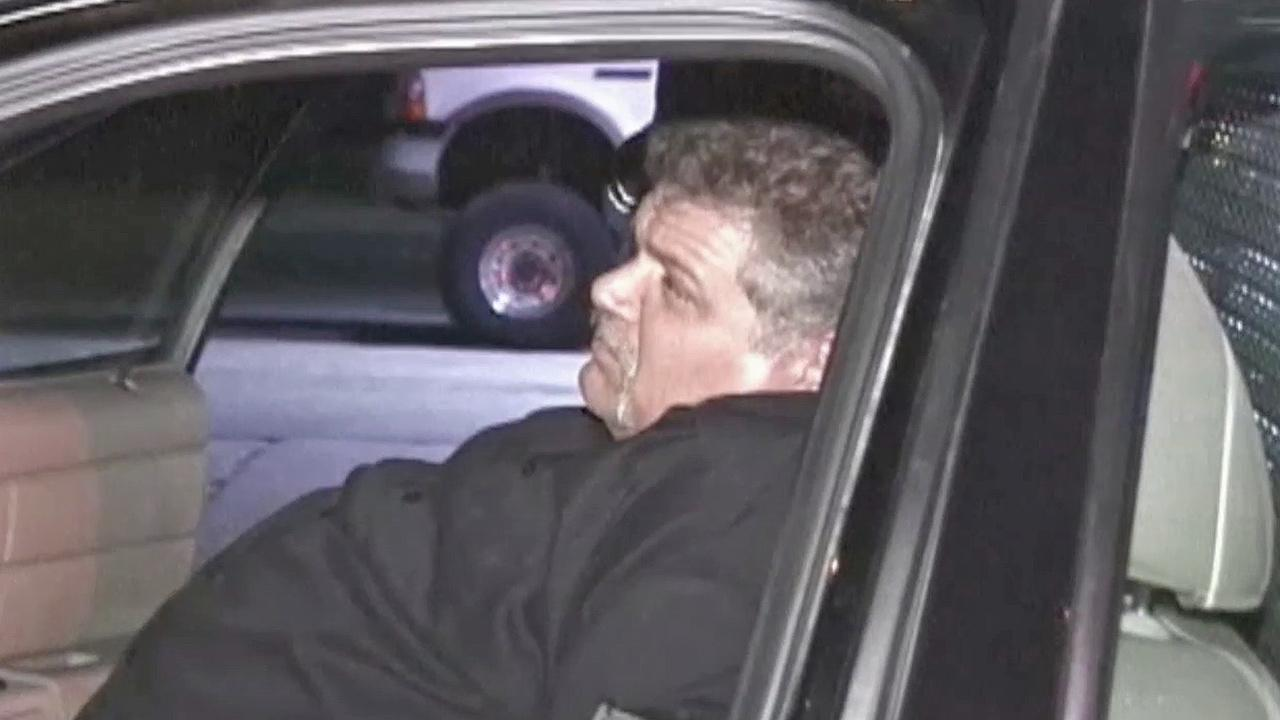 Christian Johnson, 46, is seen after being arrested on Saturday, Oct. 26, 2013.