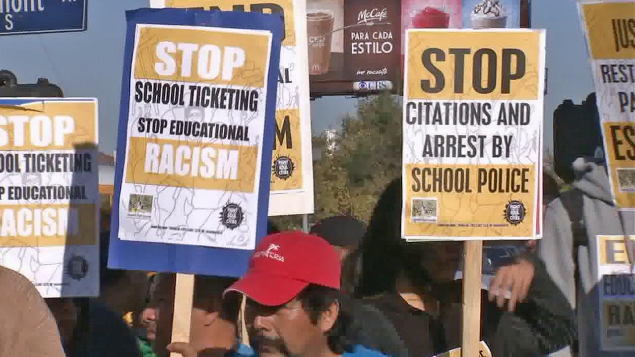 Members of the Community Rights Campaign and its supporters marched near Manual Arts High School on Wednesday, Oct. 30, 2013, accusing the Los Angeles School District and its police of targeting black and Latino students.