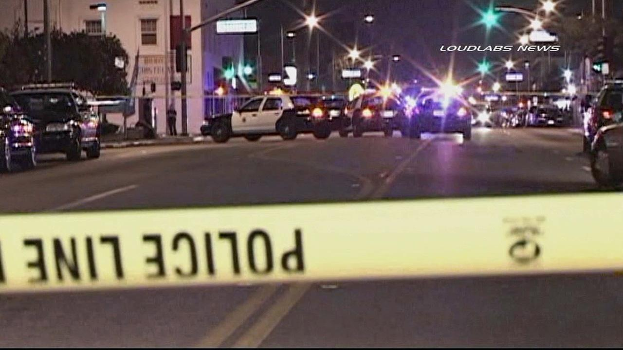 Authorities investigate a fatal officer-involved shooting in the area of Anaheim Street and Magnolia Avenue in Long Beach on Sunday, Nov. 10, 2013.