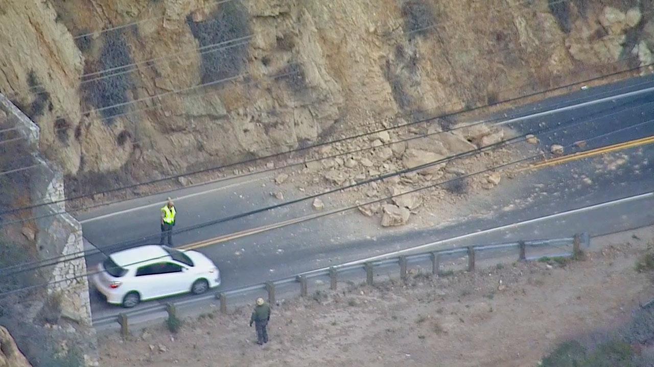 Large boulders block lanes of Malibu Canyon Road at Las Virgenes Road following a rockslide Monday, Nov. 11, 2013.