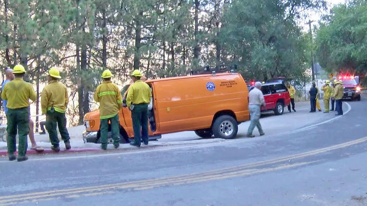 Emergency officials gather at Angeles National Forest near Hermit Falls, where a student hiker died after jumping into a pool of water on Monday, Nov. 11, 2013.