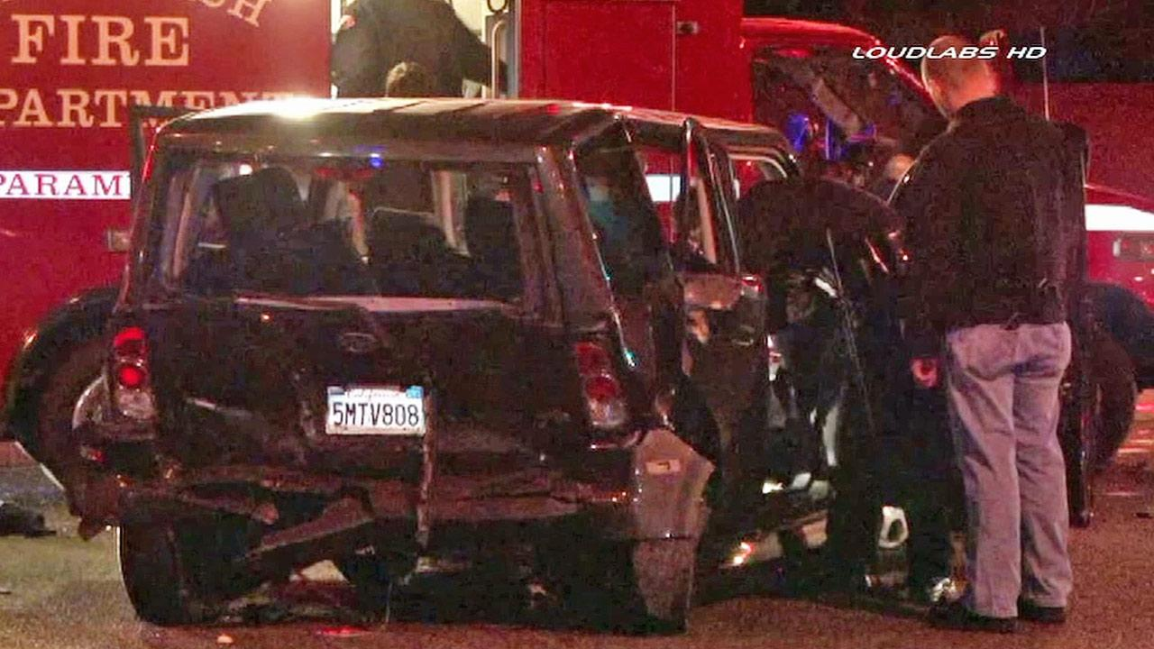 A wrecked vehicle is shown at the scene of a hit-and-run crash in Long Beach on Friday, Nov. 22, 2013.