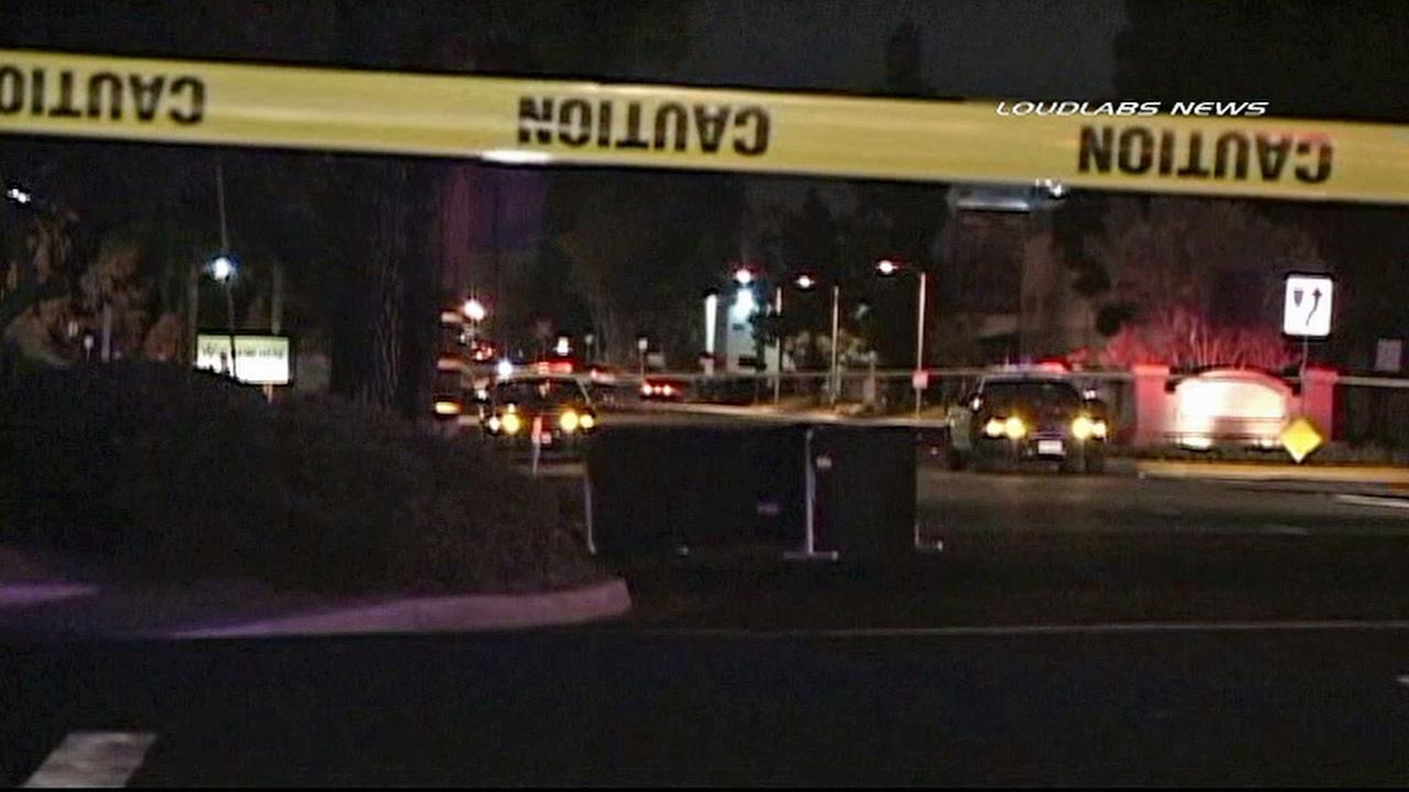 Crime scene tape ropes off the 14300 block of Alondra Boulevard in La Mirada after a man was found dead on the street on Sunday, Nov. 24, 2013.