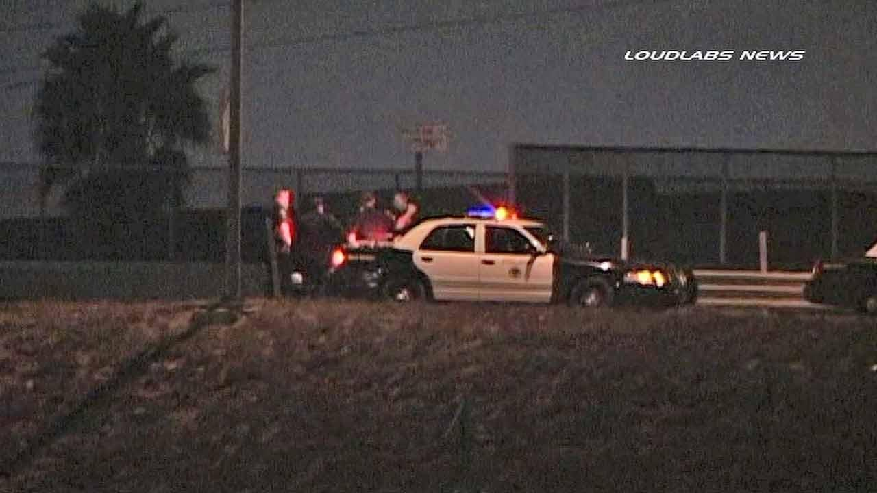 Authorities respond to the scene of a fatal car pursuit near Magnolia Avenue and Pacific Coast Highway in Long Beach Sunday, Nov. 24, 2013.
