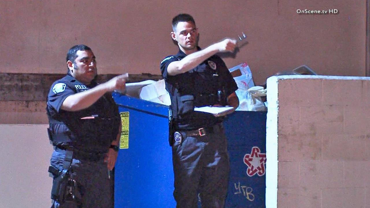 Law enforcement officials are shown at the scene of a fatal stabbing in the 11900 block of Grevillea Avenue in Hawthorne on Friday, Dec.7, 2013.