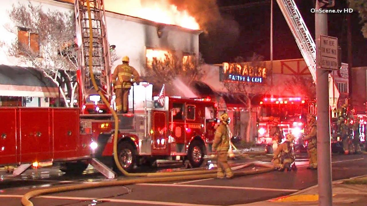 Firefighters are shown battling a fire that ripped through a two-story commercial building on the 1800 block of West Glenoaks Boulevard in Glendale on Saturday, Dec. 14, 2013.