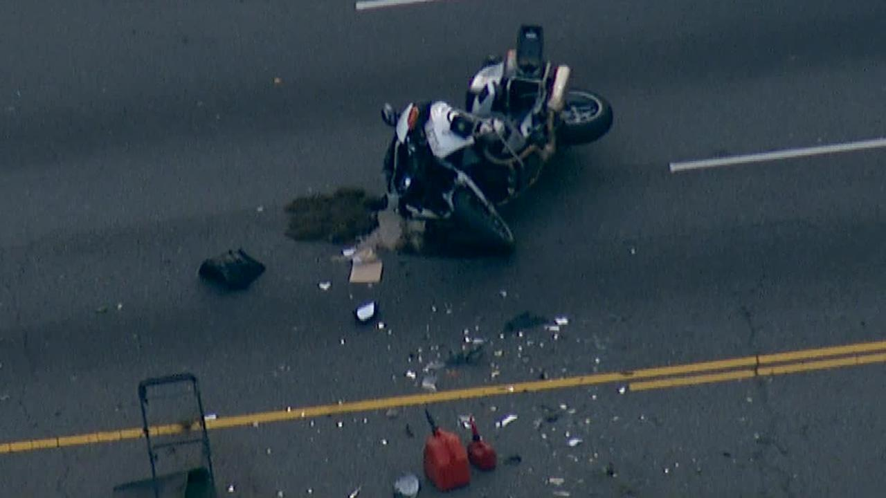 A motorcycle officer was injured in a crash in Los Angeles Mid-City area on Wednesday, Dec. 18, 2013.