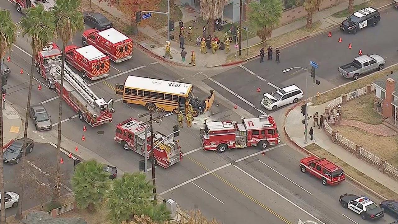 Emergency vehicles are shown at the scene of a crash between a school bus and a passenger vehicle in the 7000 block of Corbin Avenue in Reseda on Thursday, Dec. 19, 2013.