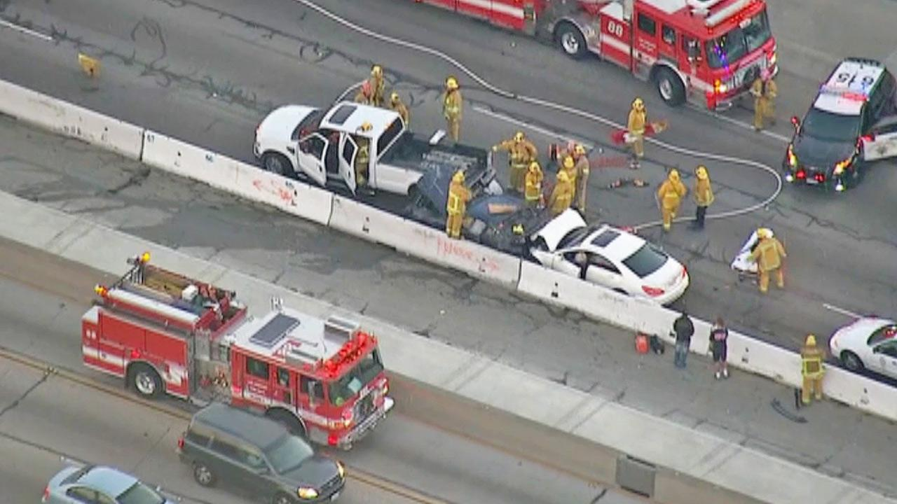 Emergency personnel gather near the scene of a fatal multiple-car crash on the northbound 405 Freeway in the Sepulveda Pass on Friday, Dec. 20, 2013.