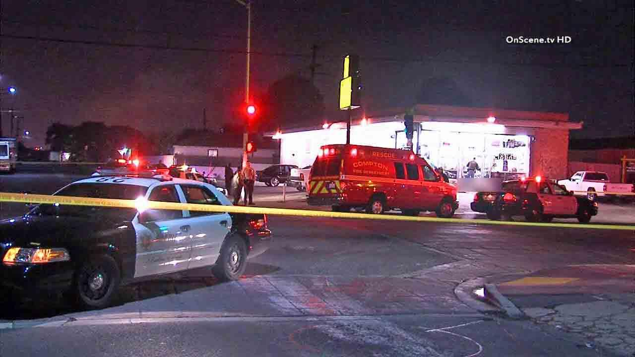 An investigation is underway on the 1000 block of Compton Boulevard in Compton after a man was found shot to death Saturday, Dec. 21, 2013.