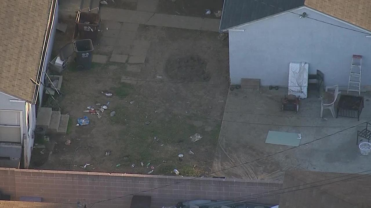 An investigation is underway after a body was found in the backyard of a Compton home on Tuesday, Dec. 24, 2013.