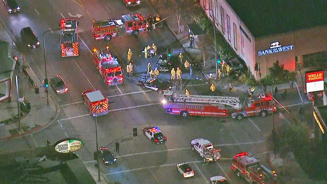 Fire engines and other emergency vehicles are shown near the site of a violent car crash near Ventura Boulevard and Oakdale Avenue in Woodland Hills on Thursday, Dec. 27, 2013.