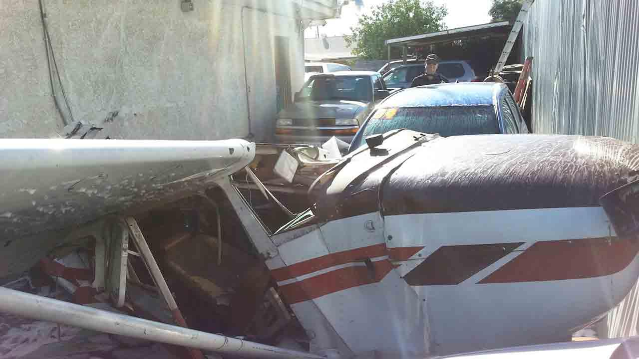 A single-engine Cessna 172 plane crashed into a parking lot across San Fernando Road near Whiteman Airport in the Pacoima area of Los Angeles Sunday, Dec. 29, 2013.