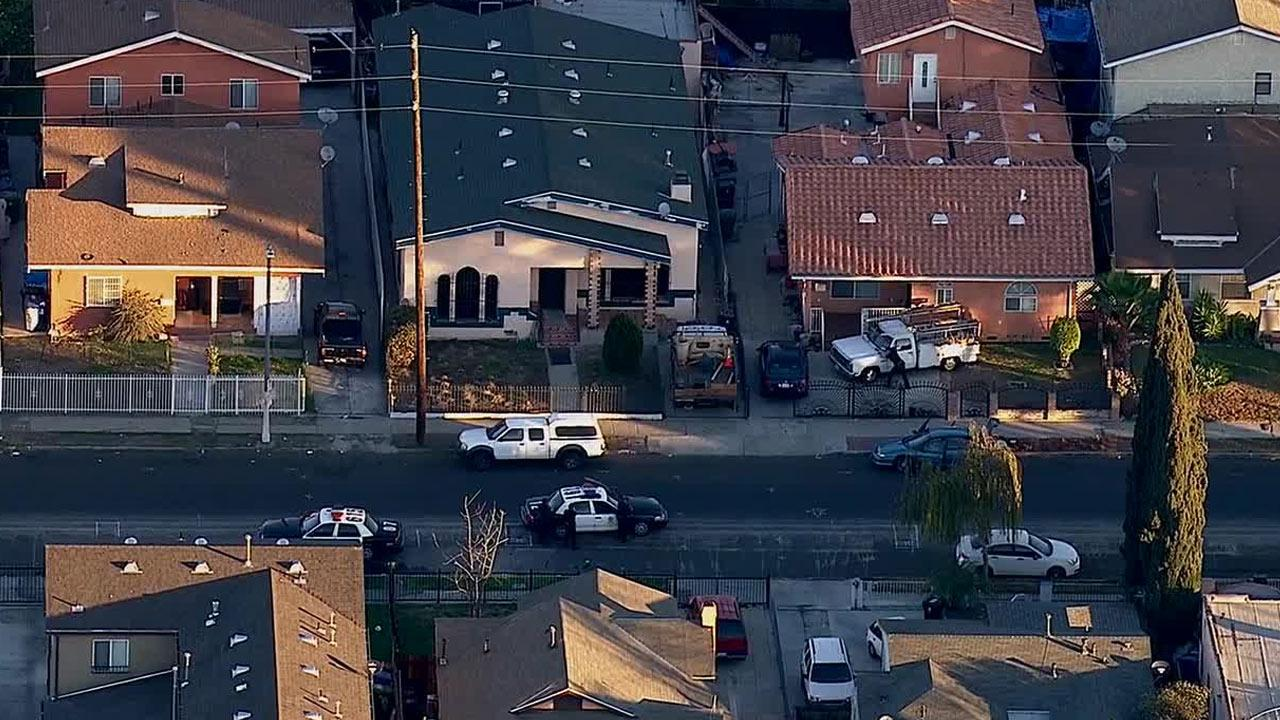Police surround a South Los Angeles home where a robbery suspect barricaded himself on Tuesday, Jan. 14, 2014.