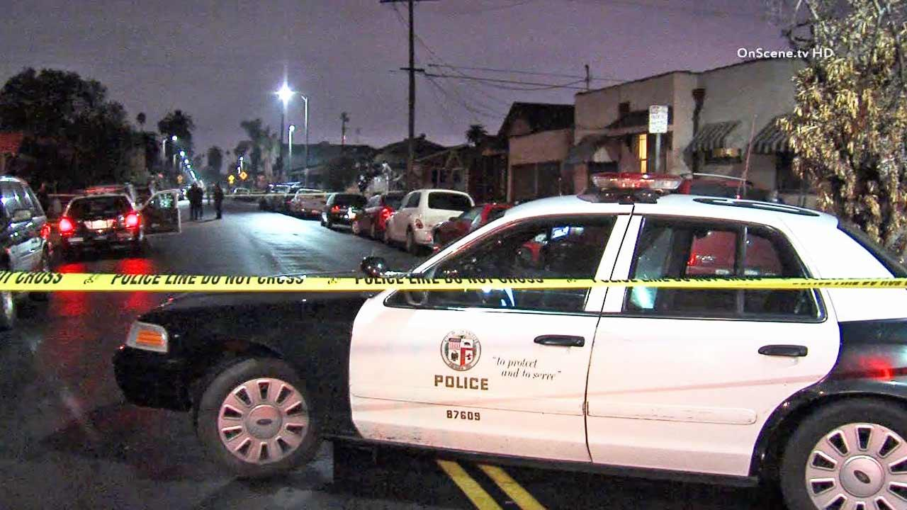 A police patrol vehicle is shown behind crime tape near the scene of a shooting in the 5300 block of Budlong Avenue in South Los Angeles on Friday, Feb. 7, 2014.