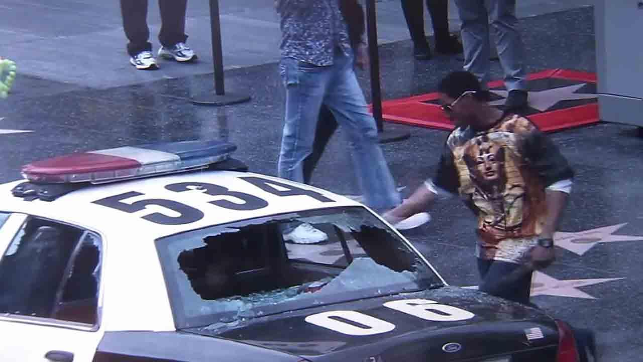 Leyston Rice, 27, is seen smashing the windows of a police car on Hollywood Boulevard on Tuesday, Feb. 11, 2014.