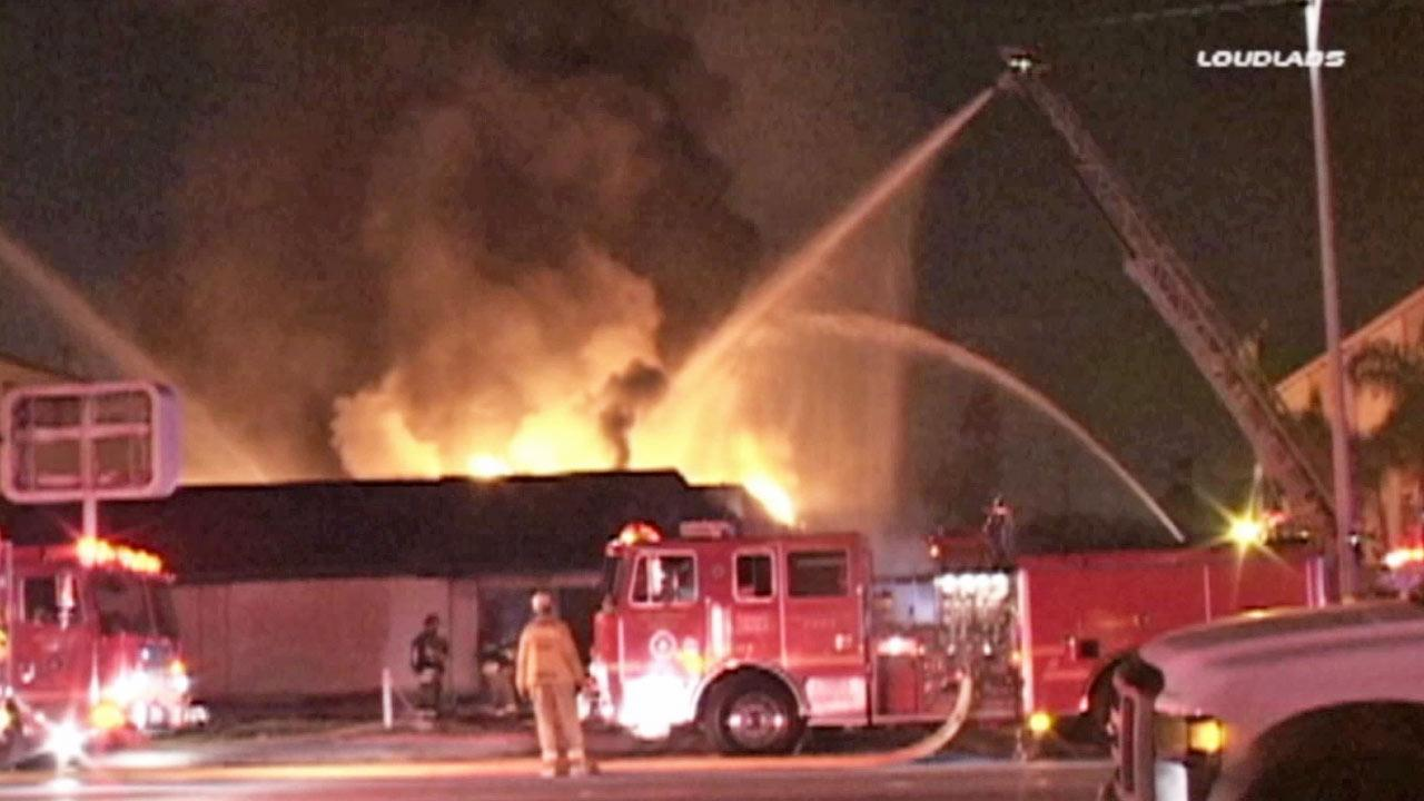 Firefighters battle flames at a warehouse in Pico Rivera on Wednesday, Feb. 19, 2014.