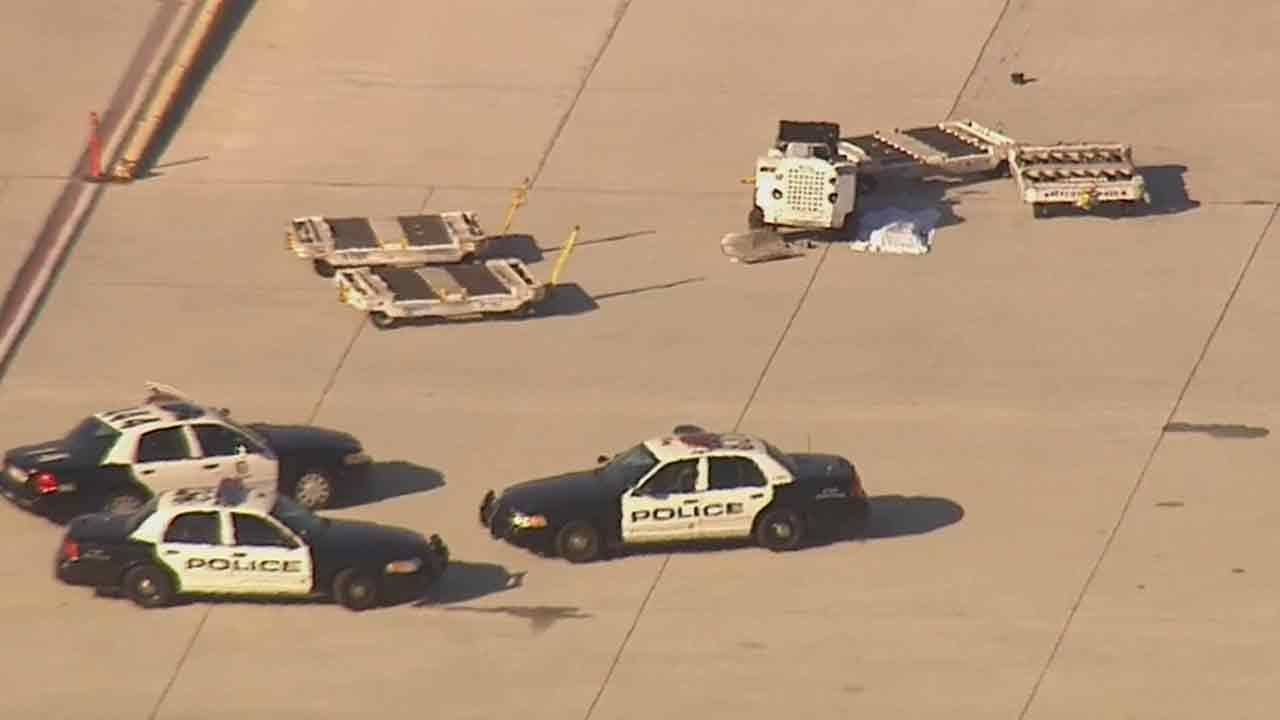 An employee was killed at Los Angeles International Airport after being struck by a luggage cart near midfield service road Romeo Friday, Feb. 21, 2014.