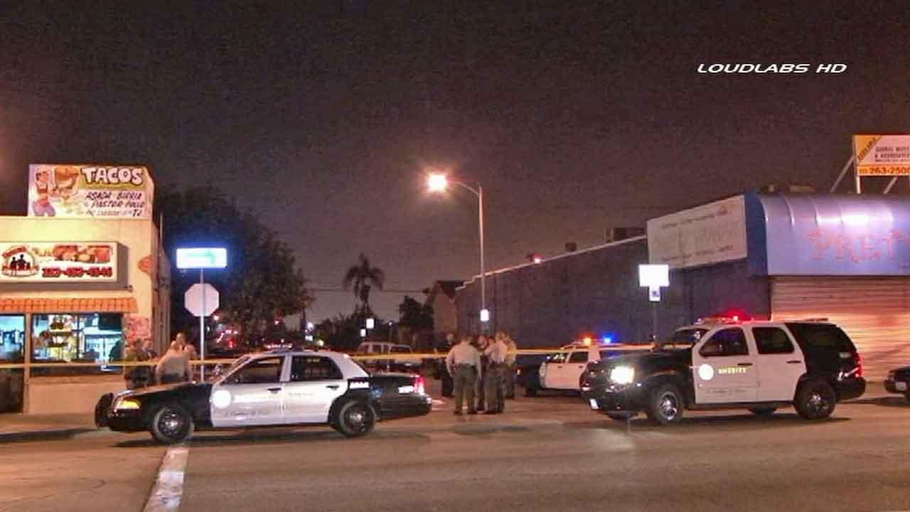 Authorities respond to the scene of a fatal shooting on the 900 block of Fraser Avenue in East Los Angeles Friday, Feb. 21, 2014.