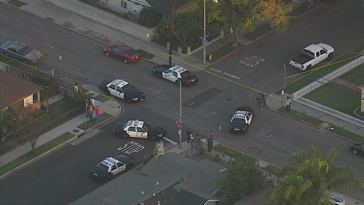 Authorities investigate after two people were found dead inside a home on the 5800 block of Rose Avenue in Long Beach on Thursday, March 6, 2014.