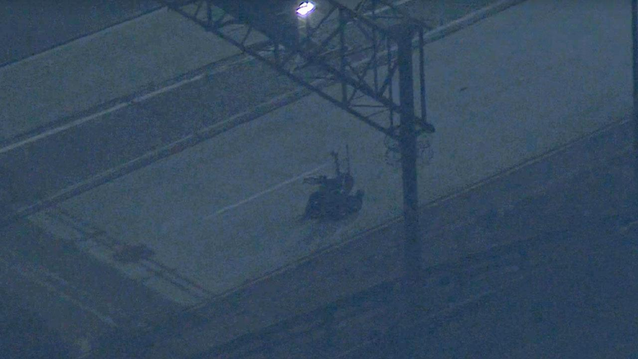A bomb-squad robot was used to investigate a suspicious package on the westbound 134 Freeway Friday night, March 14, 2014.