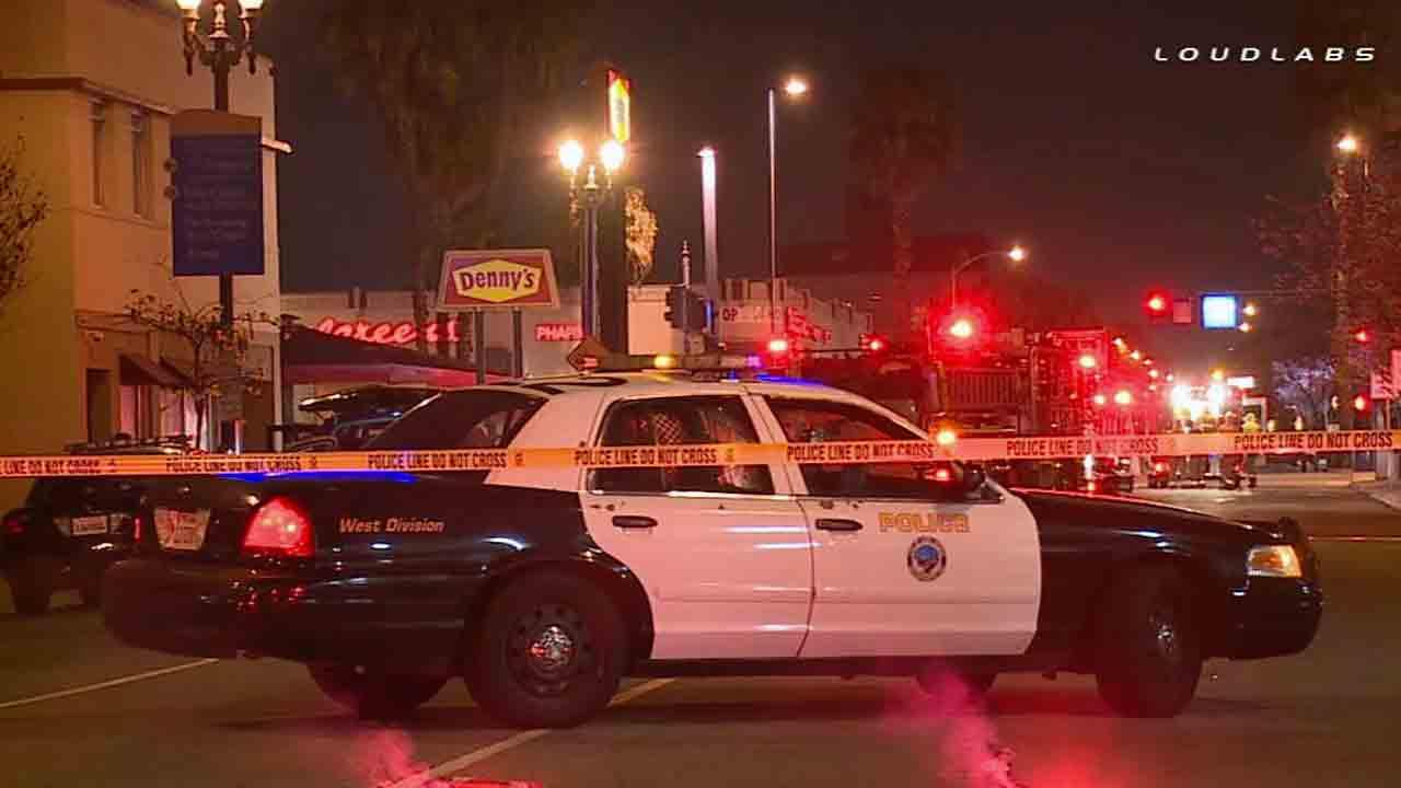 Long Beach police respond to the scene of a fatal shooting in the parking lot of a Dennys restaurant near 6th Street and Long Beach Boulevard Sunday, March 23, 2014.