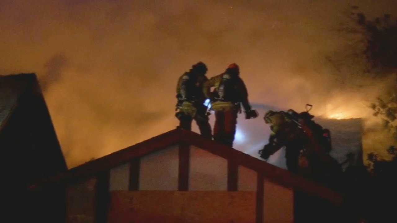 Four firefighters suffered minor burns while battling an intense house fire in Baldwin Park Tuesday night