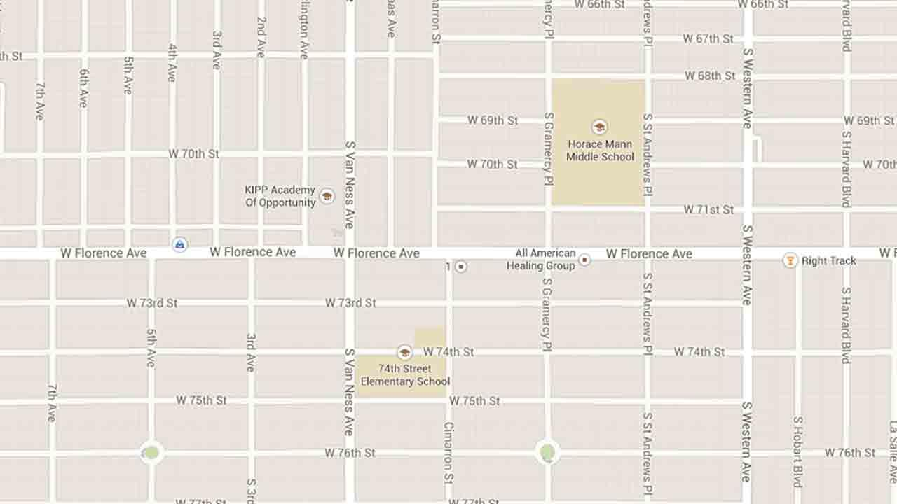 A map indicates the area near Cimarron Street and Florence Avenue in Los Angeles were two men were found fatally shot on Friday, March 28, 2014.