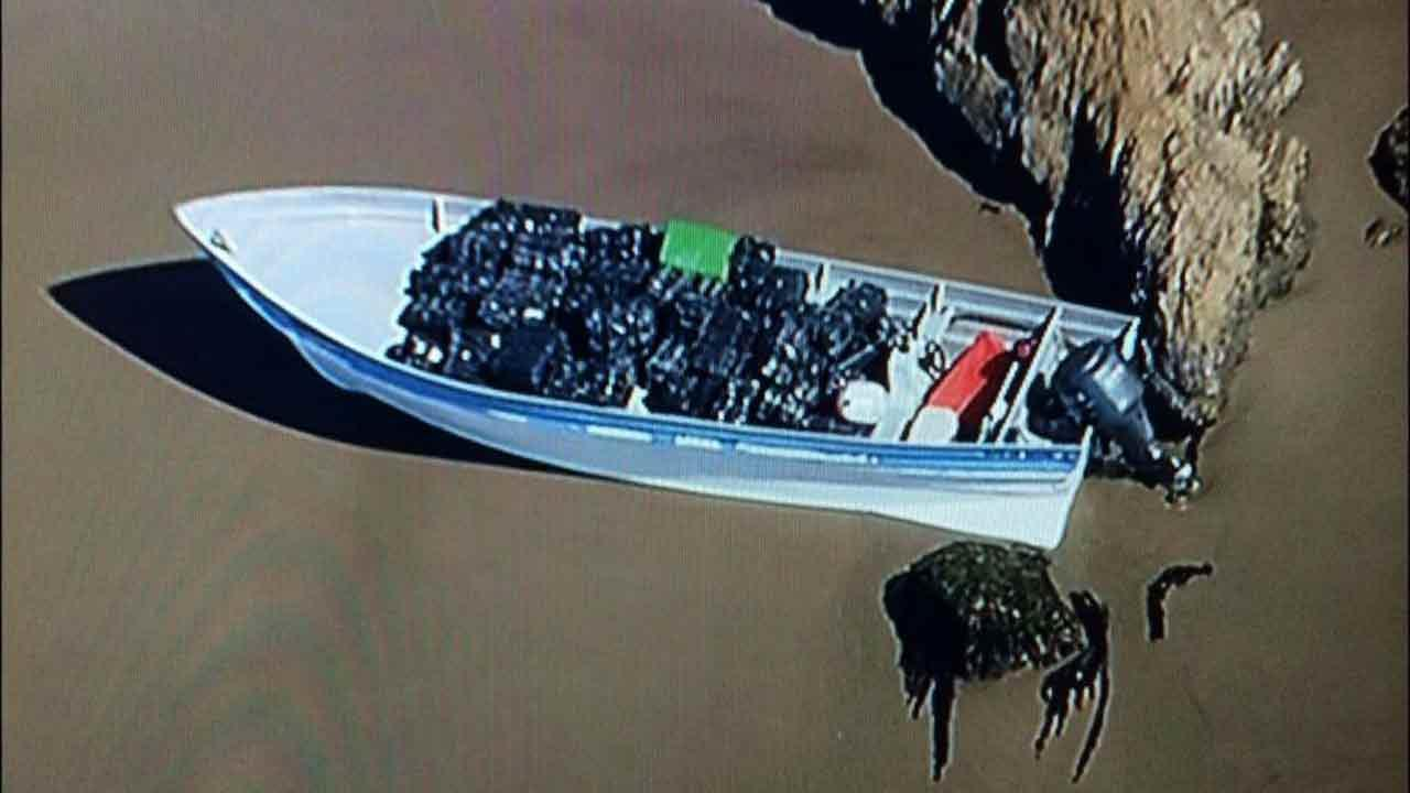 A panga boat carrying large bundles of marijuana was confiscated by authorities in Malibu Monday, April 7, 2014.